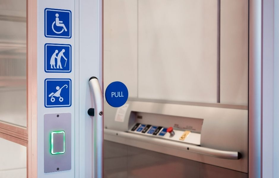 signs for universal accessibility on a door