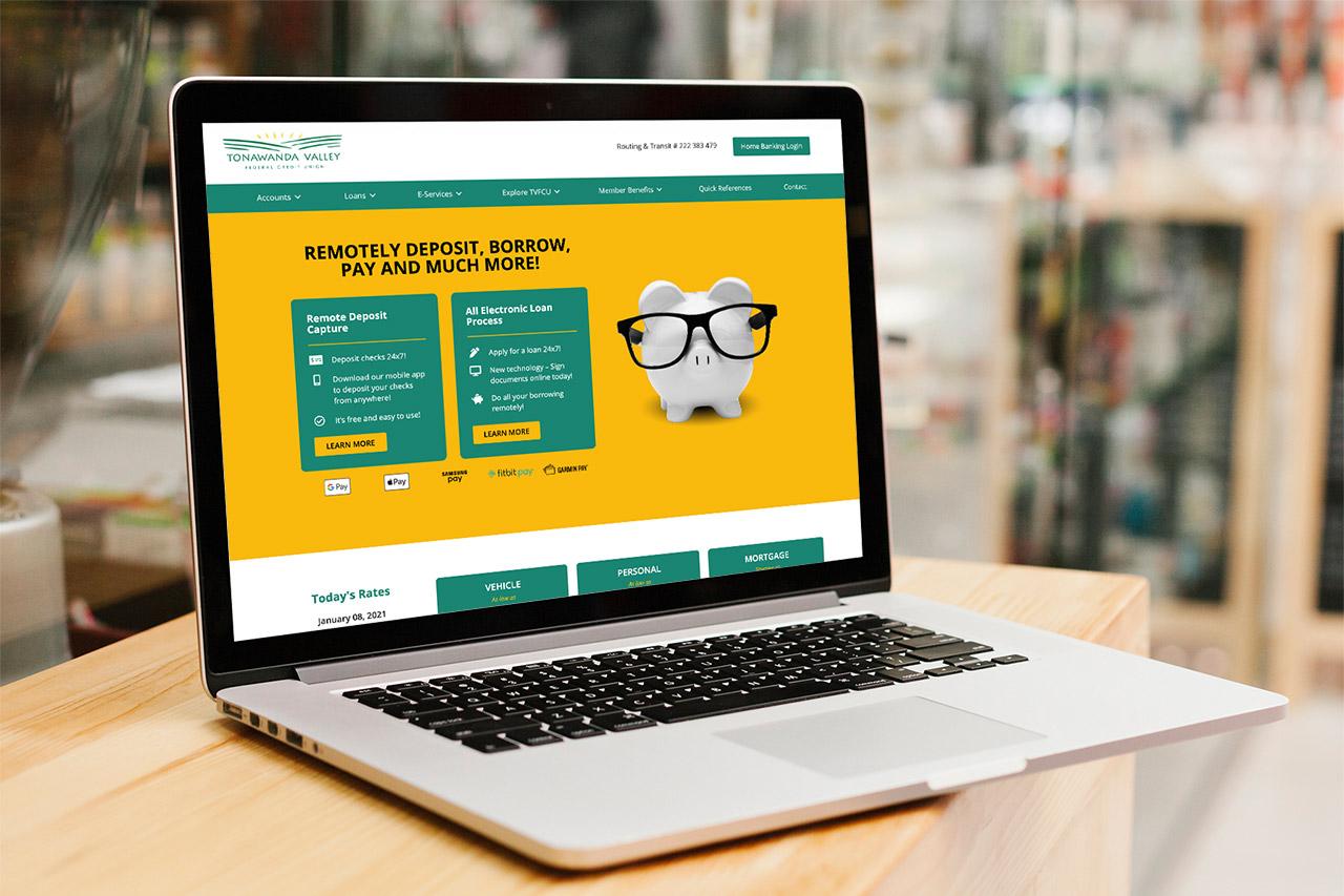 Tonawanda Valley FCU website design on laptop